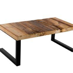 Prezentowany stolik kawowy to ciekawy mebel o surrealistycznej formie. Jego górną część stanowi blat wykonany z jednolitego kawałka drewna.